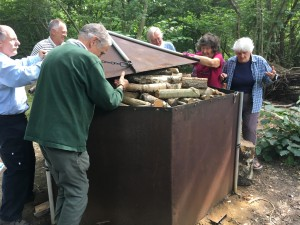 Putting the lid on the charcoal kiln