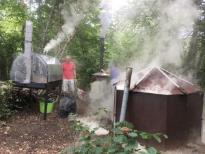 Three different charcoal kilns in action